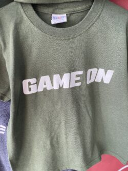 front of game on t-shirt